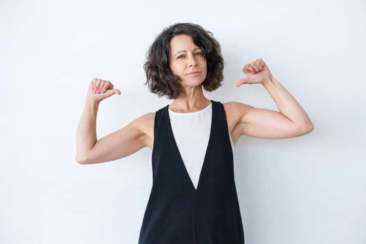 Confident woman pointing at herself